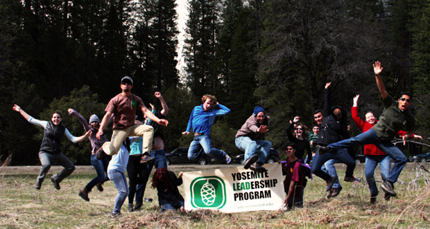 YLP members jumping in front of the YLP banner